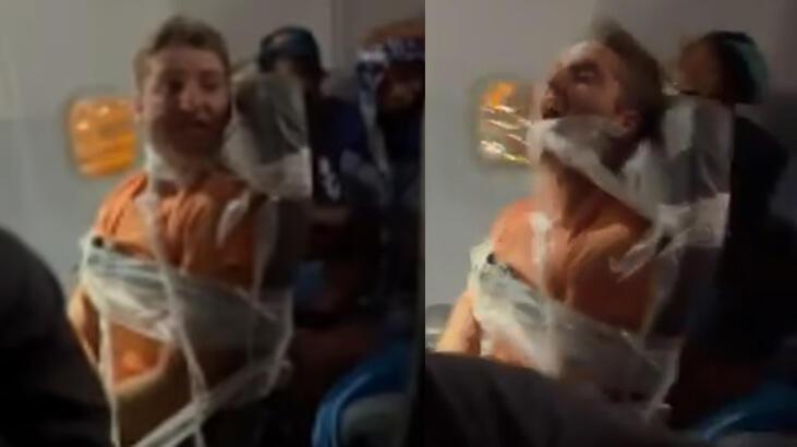 Son dakika: Uçağı birbirine katan yolcunun ağzını bantlayıp koltuğa bağladılar