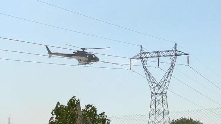 Yüksek gerilim hattı helikopterle temizlendi, vatandaşlar paniğe kapıldı