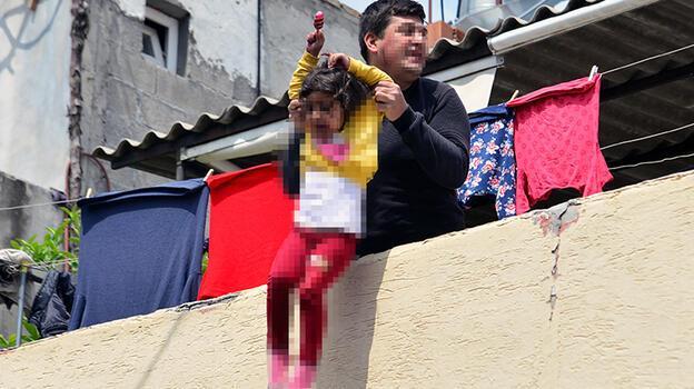 Son dakika... Kızını damdan sarkıtarak atacağını söyleyen baba, tutuklandı