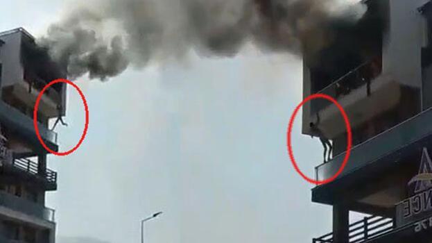 Alevlerin arasında can pazarı! 5'inci kattaki daireden alt kata sarkarak kurtuldu