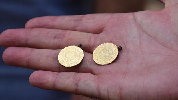 Altınların sahibini faturadan buldu!