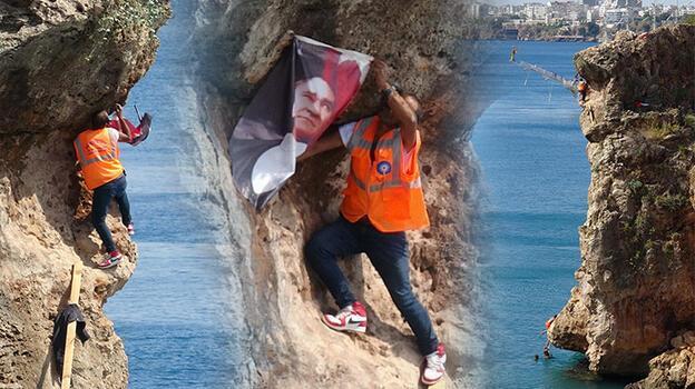 Atatürk posterini falezlere asmak isterken zor anlar yaşadı