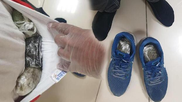 Havalimanında vücuduna sarılı uyuşturucu ile yakalandı