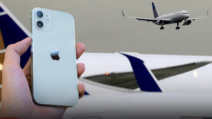 iPhone'dan gönderdiği fotoğraf uçakta ortalığı karıştırdı!