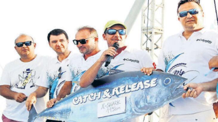 Büyük balık için yarıştılar