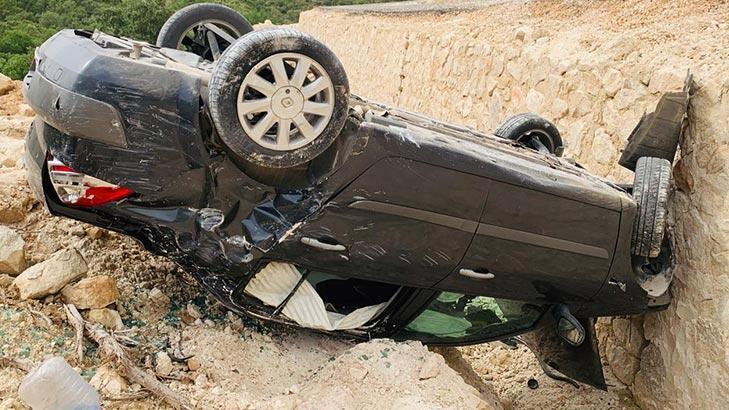 Son dakika... Takla atan otomobilin sürücüsü yara almadan kurtuldu!