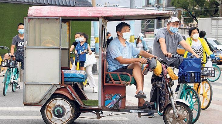 Pekin yeniden karantinada! Okullar kapatıldı, uçuşlar iptal edildi