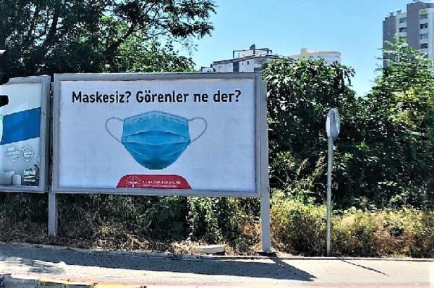 Vatandaşlar koronavirüse karşı afişlerle uyarılıyor