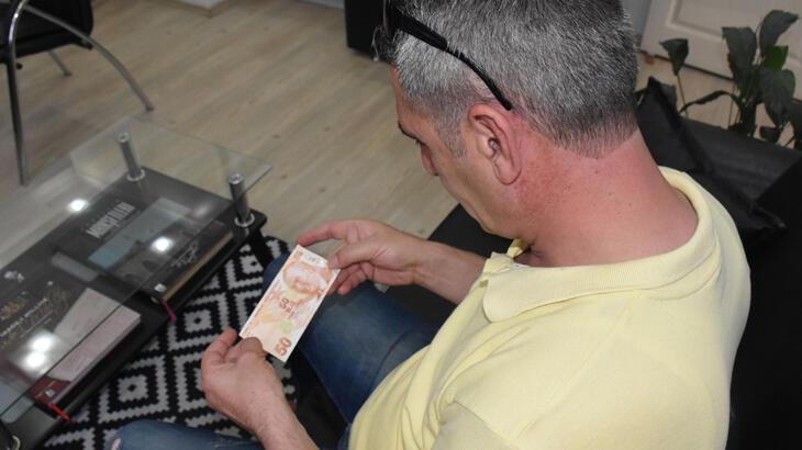 ATM'den çektiği 50 lira baskı hatalı çıktı
