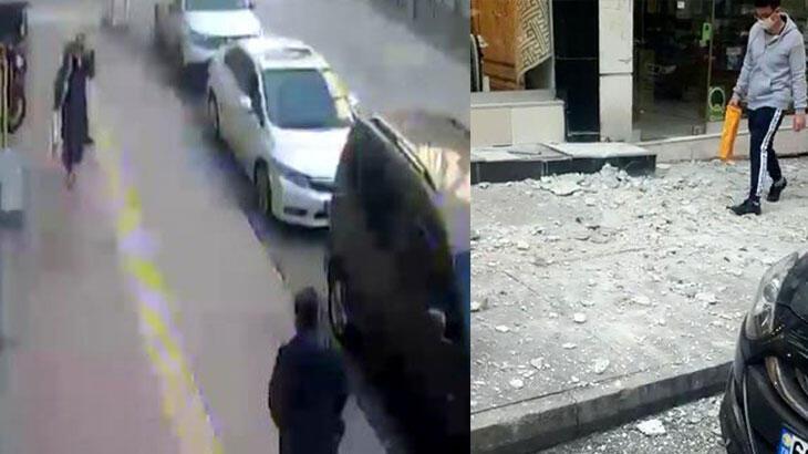 Rüzgarda apartmanın dış cephe kaplamasının düşme anı kamerada