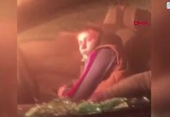 Yanan araçta uyuyakalan alkollü sürücüyü böyle kurtardı