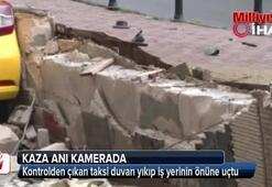 Kontrolden çıkan taksi duvarı yıkıp iş yerinin önüne uçtu
