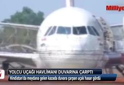 Yolcu uçağı havalimanı duvarına çarptı