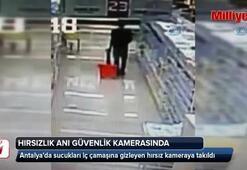 Sucukları iç çamaşırına gizleyen hırsız kameraya takıldı