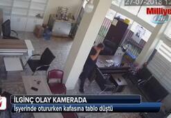 İşyerinde otururken kafasına tablo düştü