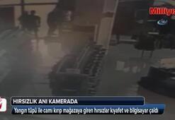 Yangın tüpü ile camı kıran elbise hırsızları kamerada