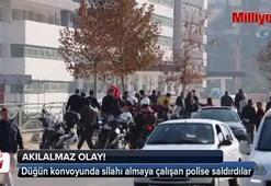 Düğün konvoyunda silahı almaya çalışan polise saldırı