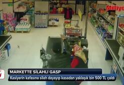 Markete girip silahla gasp yapan şahıs kamerada