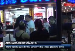 'Hero' tişörtü giyen bir kişi yemek yediği sırada gözaltına alındı
