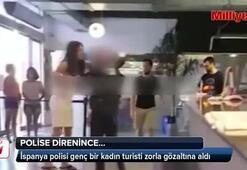 Polis genç kadını zorlukla tutukladı