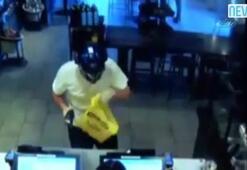 Silahlı soyguncuyu sandalyeyle etkisiz hale getirdi