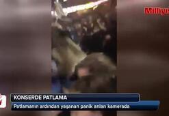 Patlamanın ardından konser salonunda yaşanan panik kamerada