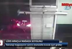 Mağazanın camını lüks araçla kıran hırsızlar kamerada
