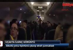 Uçakta alkollü yolcudan ilginç görüntü