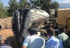 Yan yatan hafriyat kamyonunun şoförünü itfaiye kurtardı