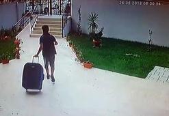 Poşetle girdiği binadan bir bavul ayakkabı çalarak çıktı