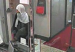 Türban takıp  banka soydu