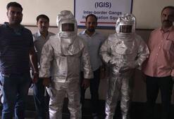 NASA çalışanı dolandırıcılar uzay giysileriyle kameralar önünde