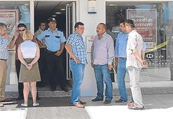 Personele biber gazı sıktı, bankayı soydu