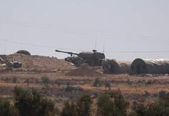 Tanklar, köylülerin alkışları eşliğinde Suriye sınırında