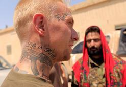 Son dakika... Eski ABD askeri YPG safında Reuters fotoğrafladı...