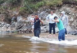 Barajın kapakları açıldı Tabiat parkında mahsur kaldılar...