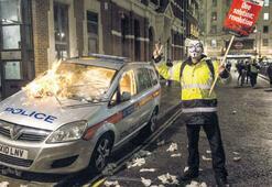 Londra'da maskeli isyan: 50 gözaltı