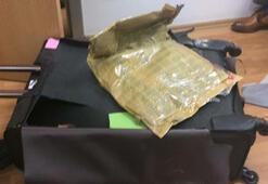 Uçaktan inen yolcunun valizinde 3 kilo 394 gram eroin ele geçirildi