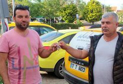 Taksi şoförü yerde bulduğu 10 bin TLyi sahibine teslim etti
