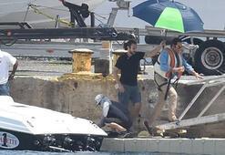 John Travolta için şemsiyeli önlem