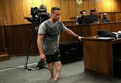 Oscar Pistorius walks on stumps to display his vulnerability