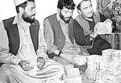 Afganistan'da para Tahir'den sorulur