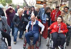 CHPli Soyer farkındalık için tekerlekli sandalye ile gezdi