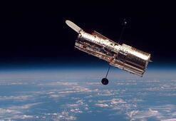 Hubble, uzay-zamanı büken dev galaksi kümesini görüntüledi