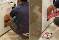 Oyun makinesinden ödülleri çalmak için çocuğunu kullandı