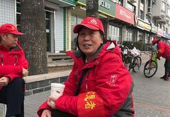 Pekin sokakları yüz binlerce güvenlik gönüllüsüyle izleniyor