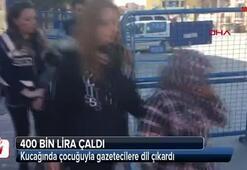 Kucağında çocuğuyla gazetecilere dil çıkardı