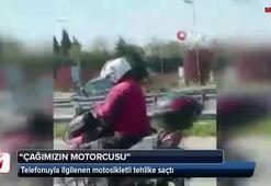 Telefonuyla ilgilenen motosikletli tehlike saçtı