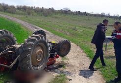 Devrilen traktörün altında feci ölüm