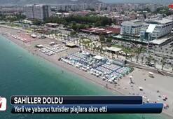 Turistler sahilleri doldurdu
